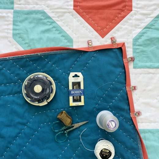 Learn how to hand sew your quilt binding onto your quilt