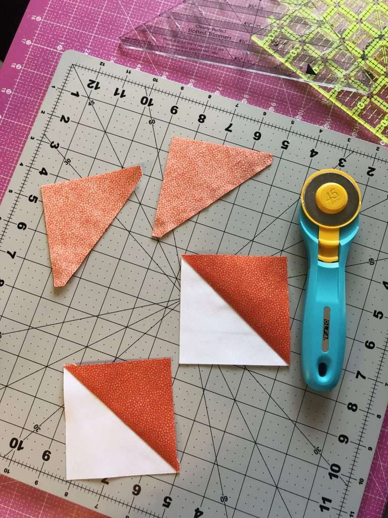Half Square Triangle Quilt Blocks, learn how to make a quilt block, 4 at a time HSTs, quilt blocks, beginner quilting, learn to quilt, modern quilting, modern quilt pattern, triangular quilt pattern, rotary cutter, quilting rulers, trimming half square triangles