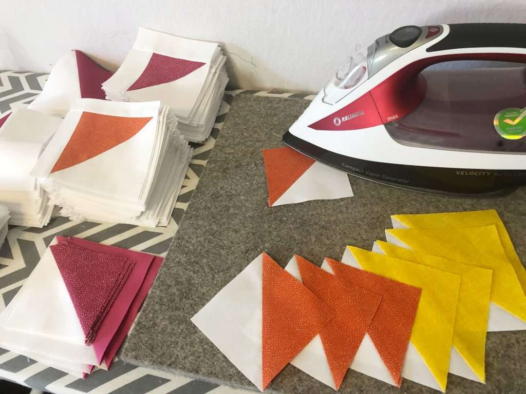 Half Square Triangle Quilt Blocks, learn how to make a quilt block, 4 at a time HSTs, quilt blocks, beginner quilting, learn to quilt, modern quilting, modern quilt pattern, triangular quilt pattern, rotary cutter, quilting rulers, pressing half square triangles, homemade emily jane, homemadeemilyjane, quilting iron