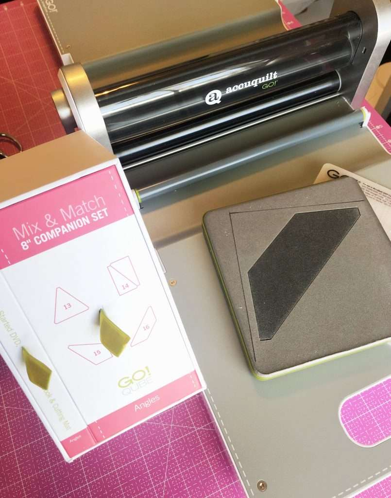 learn how to piece a quilt block, how to cut fabric with accuquilt, fabric die cut machine, accuquilt angles set, string quilt block, O quilt block, scrappy quilt block, accuquilt qube, accuquilt cube, how to use the accuquilt cube