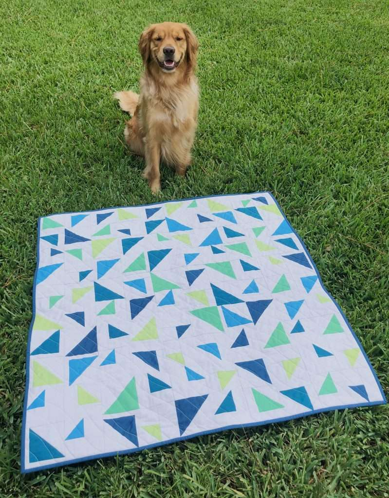 Baby size triangular quilt made with artisan cottons