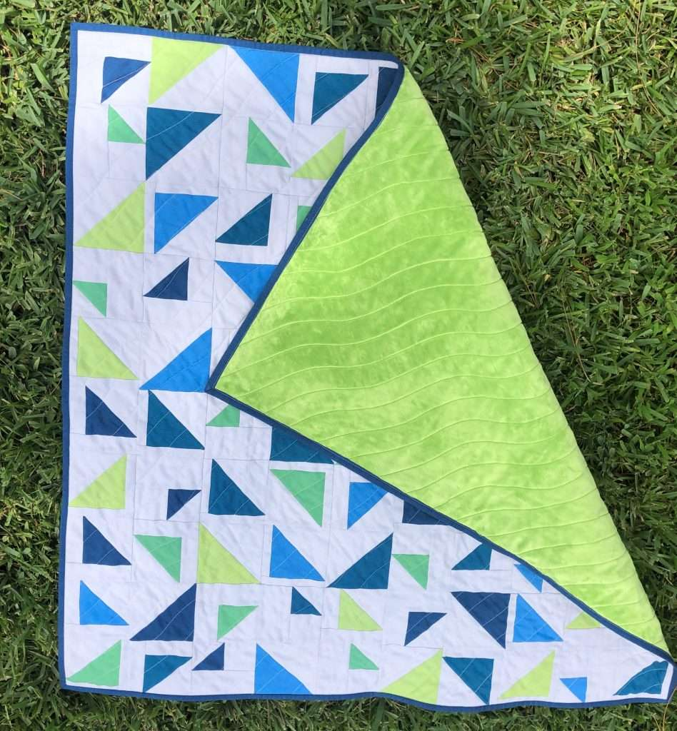 wavy line quilting design, wavy quilting texture, baby size triangular quilt, minky backing