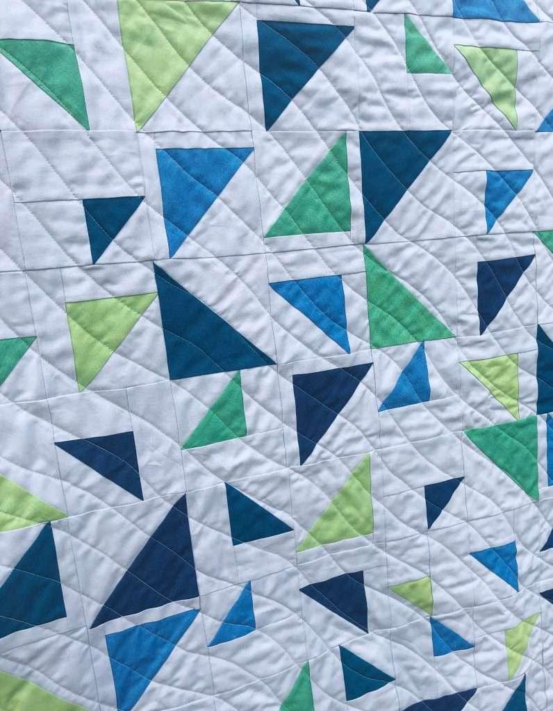 wavy line quilting design, wavy quilting texture, baby size triangular quilt