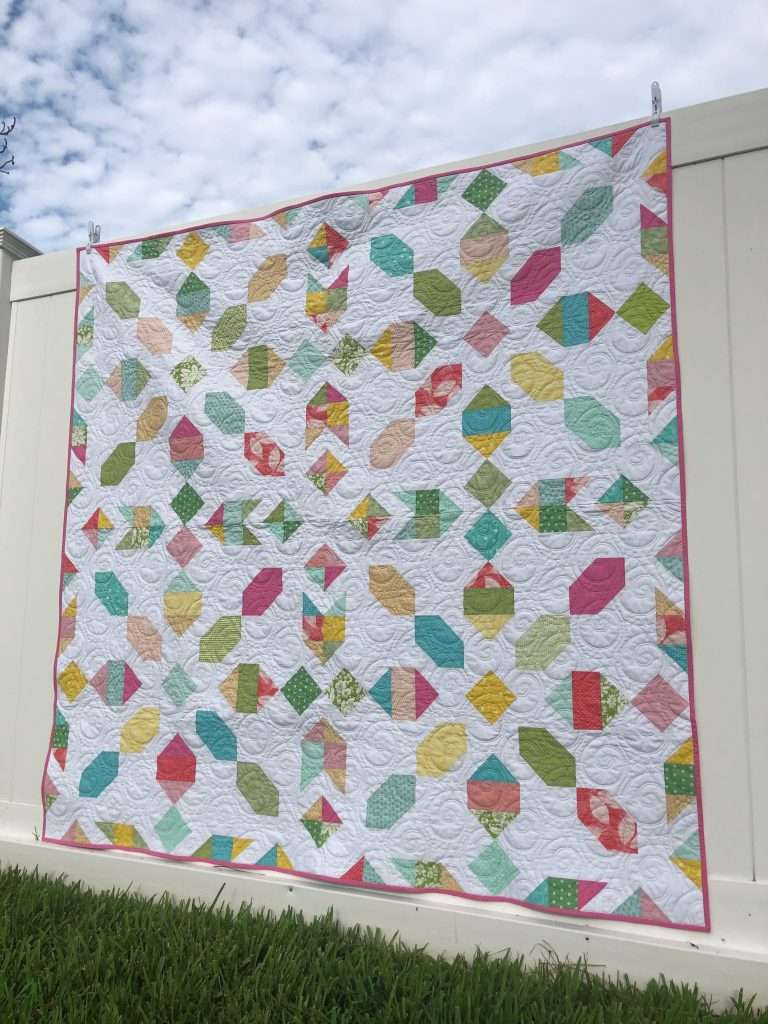 scrap-buster projects, sewing scrappy, use up your fabric scraps, accuquilt sewing, fabric scraps, ways to use up scraps of fabric, how to make a scrappy quilt, connector quilt pattern, use up scraps for quilt pattern, fat quarter friendly quilt pattern, modern quilt pattern