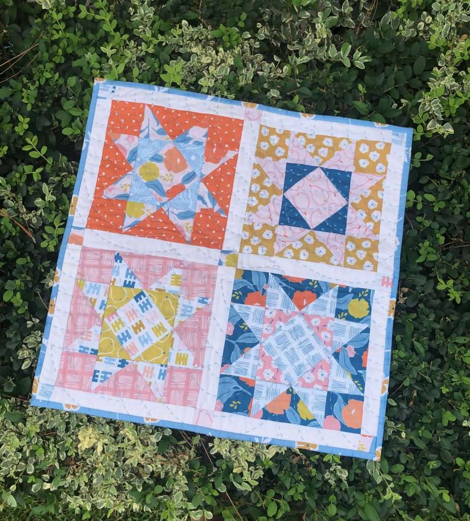 scrap-buster projects, quilting scrappy, use up your fabric scraps, accuquilt sewing, fabric scraps, ways to use up scraps of fabric, mini quilt, fabric wall hanging, sawtooth star quilt, homemade mini quilt, modern mini quilt, wall hanging quilt, scrappy quilted pillow