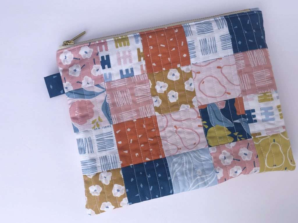 scrap-buster projects, sewing scrappy, use up your fabric scraps, accuquilt sewing, fabric scraps, ways to use up scraps of fabric, how to make a zipper pouch, quilted zipper pouch