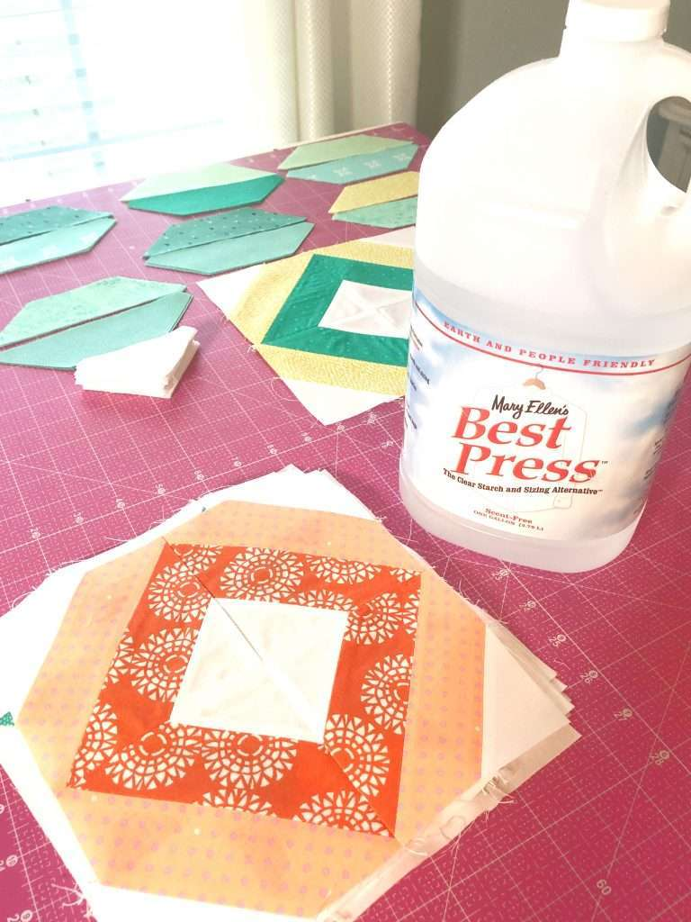 tips for pressing while quilting, ironing tips for quilting, AccuQuilt String Quilt Blocks, angles companion qube, chain sewing, modern quilting, learning to quilt, how to use accuquilt, free quilting tutorials, modern quilt pattern