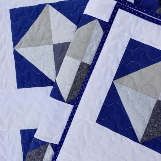 throw size solitaire quilt navy and white half square triangles