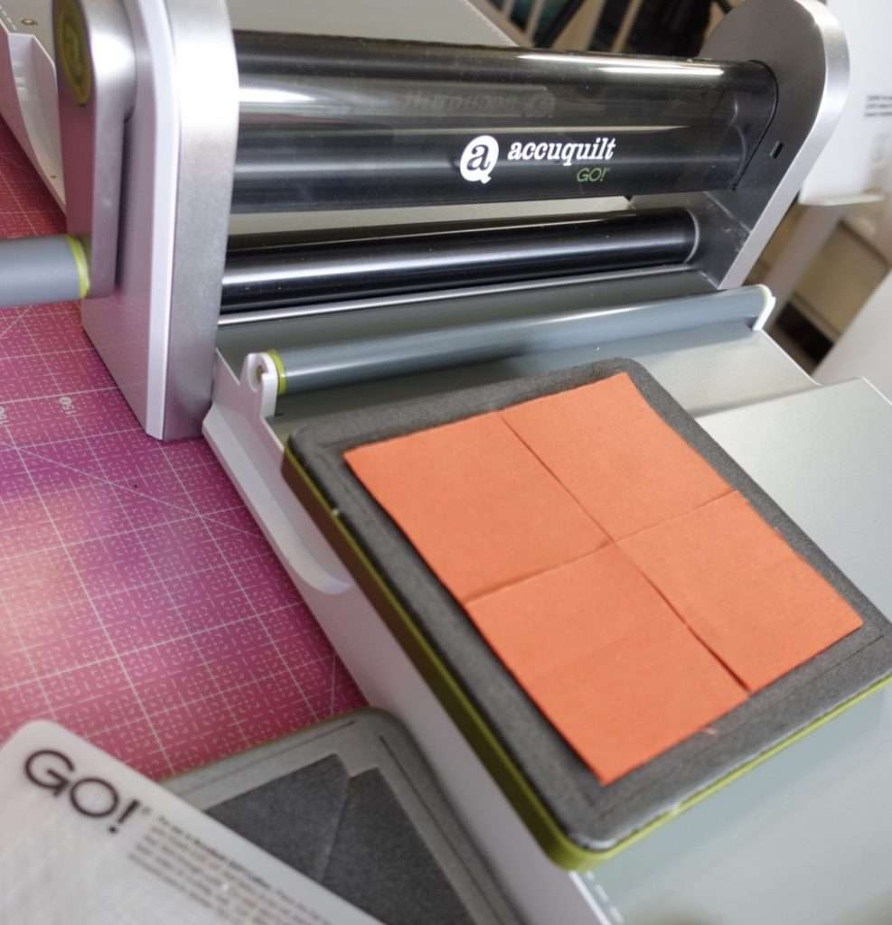Cutting perfect squares with an  AccuQuilt Go fabric cutting machine