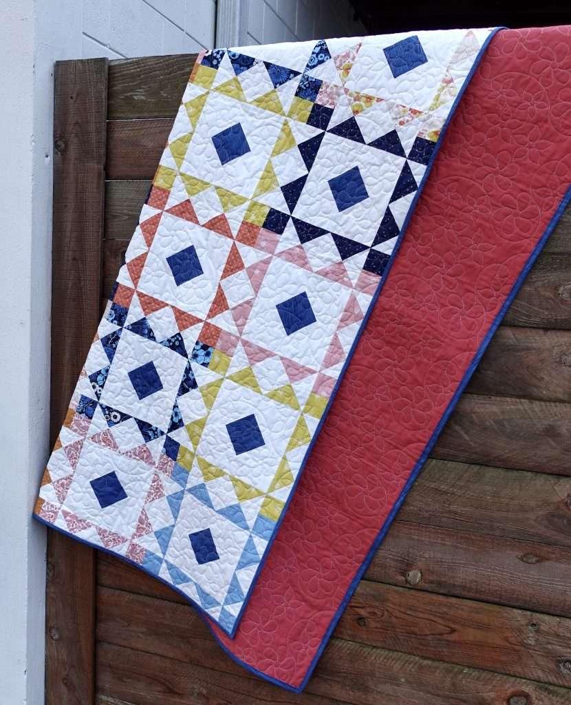 FIGO Fat quarter bundle reverberate quilt pattern, throw size quilt pattern, this modern quilt pattern also includes 6 quilt sizes and is perfect for pre-cut fabric bundles.