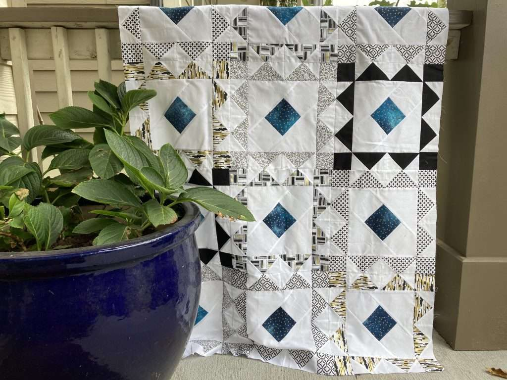Reverberate Baby Quilt by Shalini, fat quarter bundle quilt pattern, homemade emily jane, modern quilting pattern, flying geese quilt block pattern