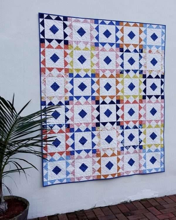 Reverberate modern quilt pattern, fat quarter quilt, brightly colored quilt, flying geese quilt, quilting tutorial, figo fabrics, prickly pear fabrics, fat quarter fabrics