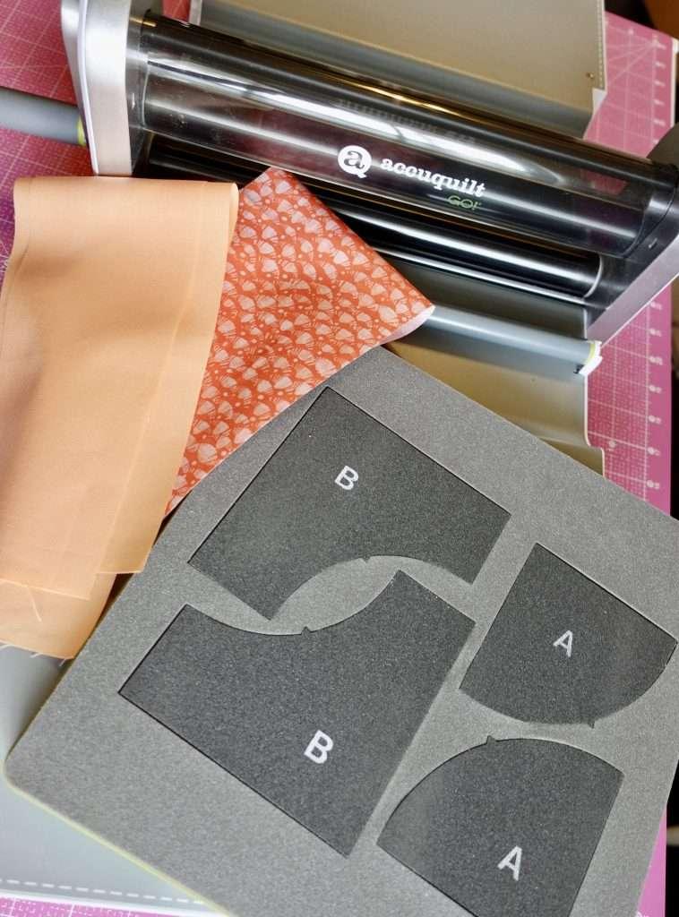 cutting out curves using AccuQuilt GO Fabric cutting machine drunkard's path die