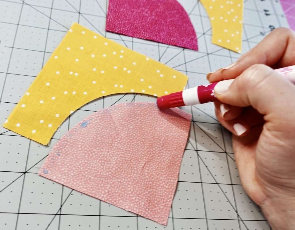 use a glue stick to baste curved fabric pieces together before sewing perfect curves