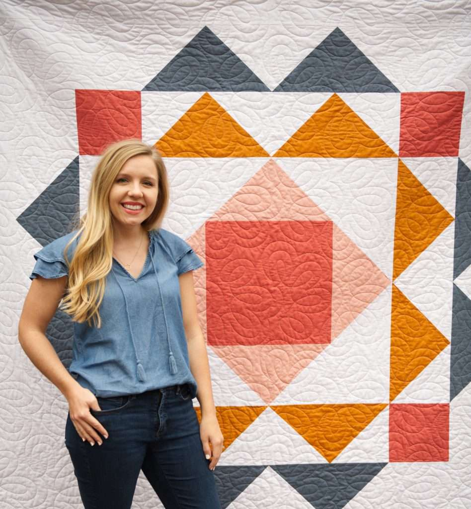 Modern geometric quilt pattern by Homemade Emily Jane, the paradigm quilt pattern features large flying geese quilt blocks and is a great way to show off quilting designs