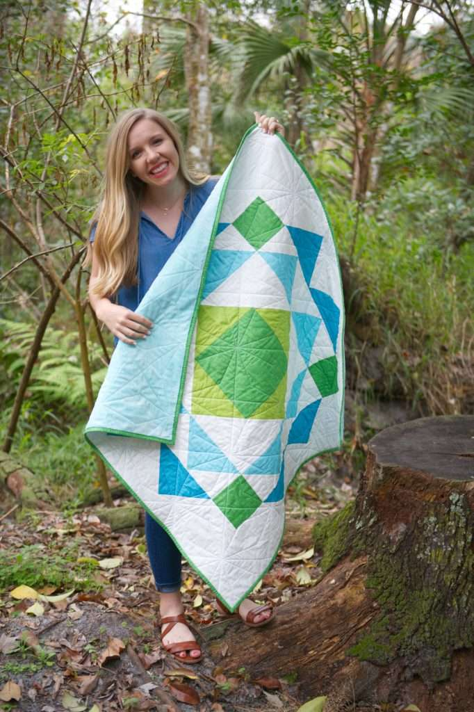 paradigm quilt pattern by homemade emily jabe is a great modern baby boy quilt pattern. If you're looking for an easy quilt pattern that features modern quilt pattern design, the Paradigm quilt pattern is perfect for you! this easy baby quilt was backed with minky fabric and is so cozy and cuddly!