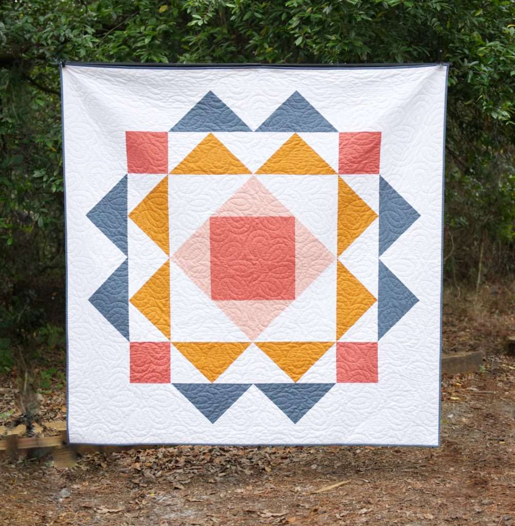 Throw size paradigm quilt by homemade emily jane, large single block quilt pattern featuring flying geese and economy quilt block