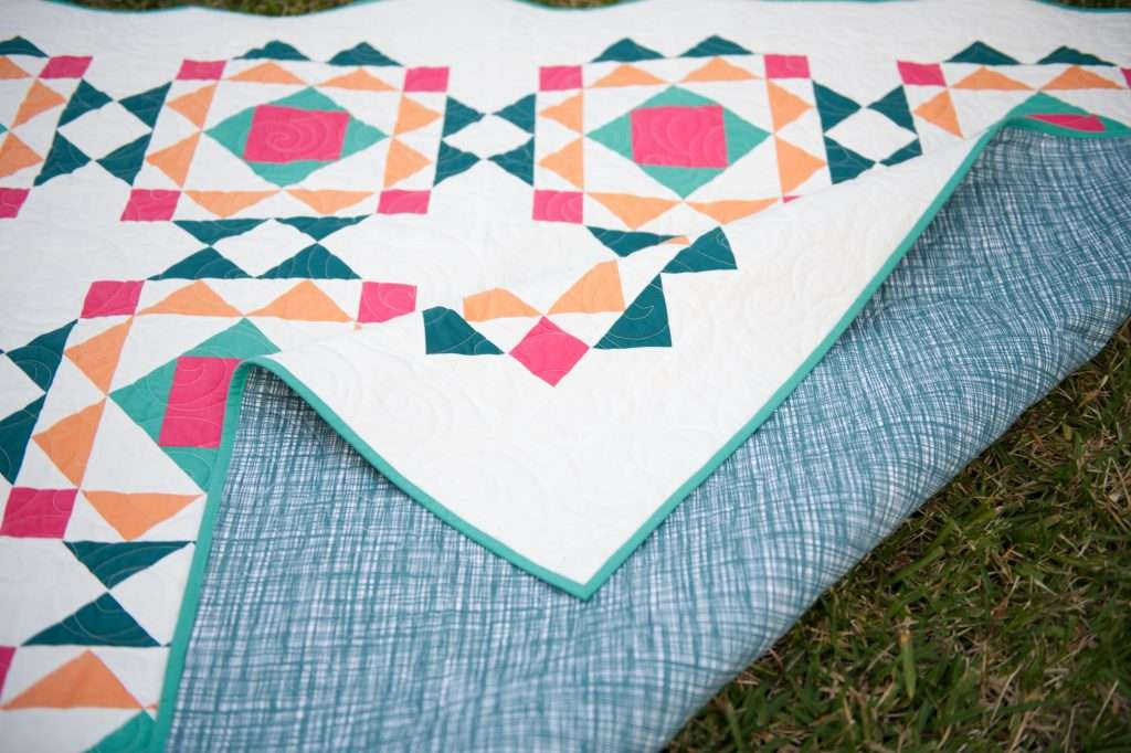 Modern block based quilt pattern, sprightly quilt pattern in throw size using solids