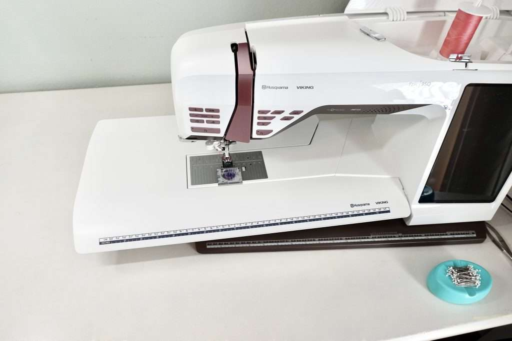 one of my favorite quilting accessories for my sewing machine is my extension table - an extension table provides extra flat space to the left of the needle to make quilting larger projects easy