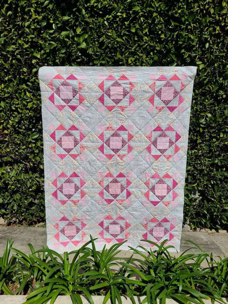 Sprightly quilt by Laura from sharingseams, throw size quilt turned into pink crib quilt