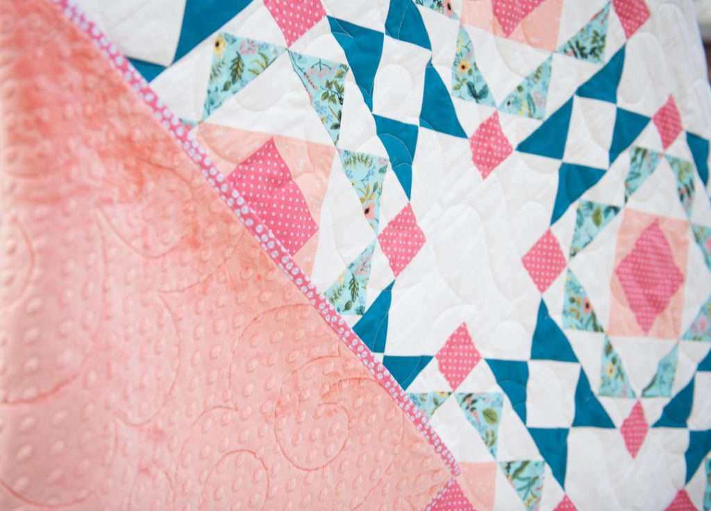 modern block based throw size sprightly quilt close up