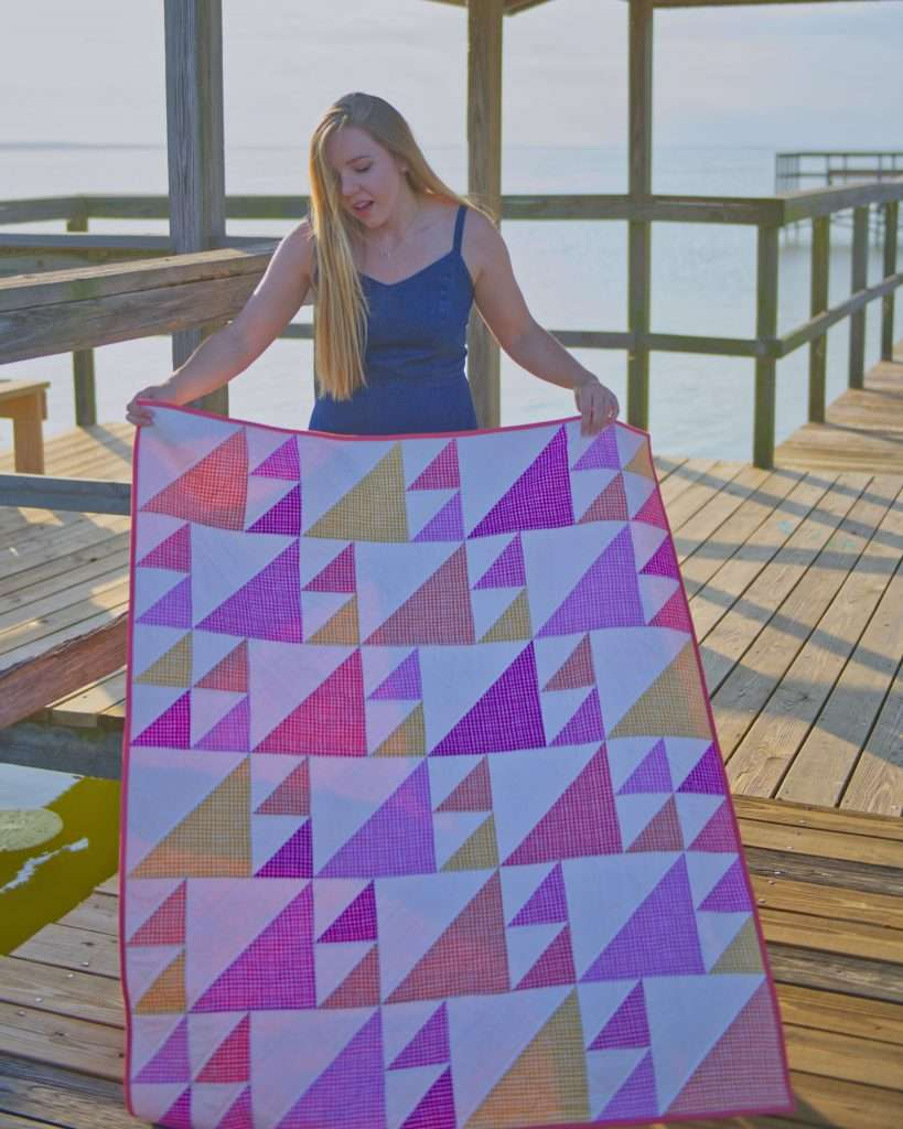 Baby girl geometric half square triangle quilt pattern