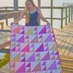 baby girl half square triangle quilt made with Gingham Play by Michael Miller fabrics