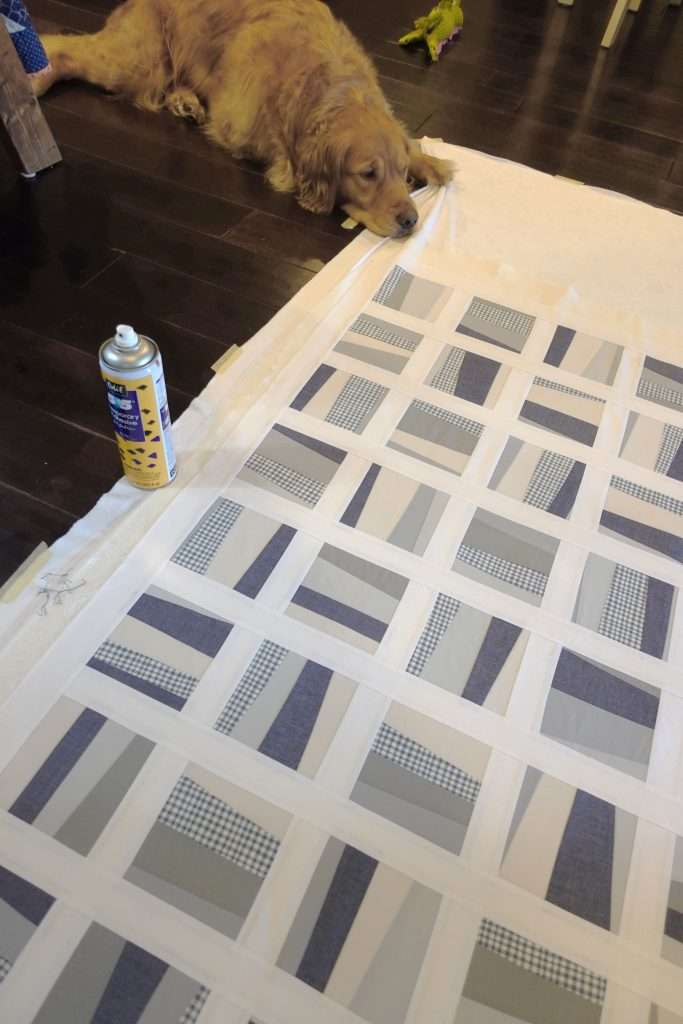 basting a quilt with minky backing. this is a wonky improv baby quilt called Stratus quilt pattern by Homemade Emily Jane